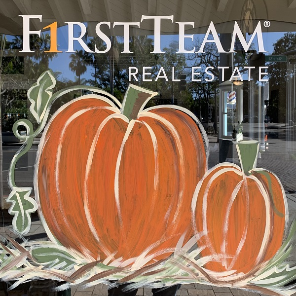First Team Real Estate Adds A Festive Fall Flair To Village Business Windows