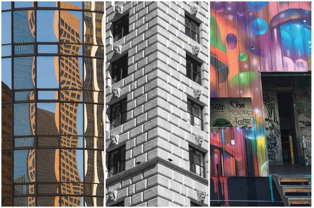 three office building facades, one mirrored, one stone, one colorfully painted