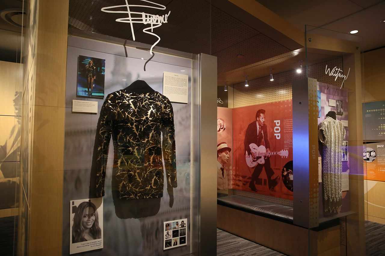 Gallery display with artist's costume