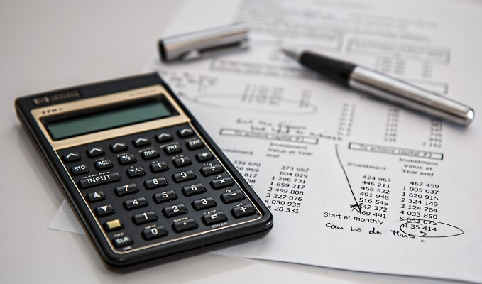 pen, calculator and paper