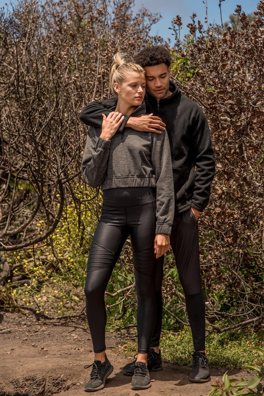 man holding woman in mono b