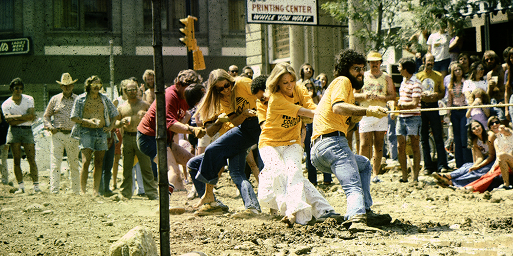 young people playing tug-of-war on the pearl street mall before it was paved