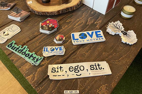 Several stacks stickers sit on a wooden table
