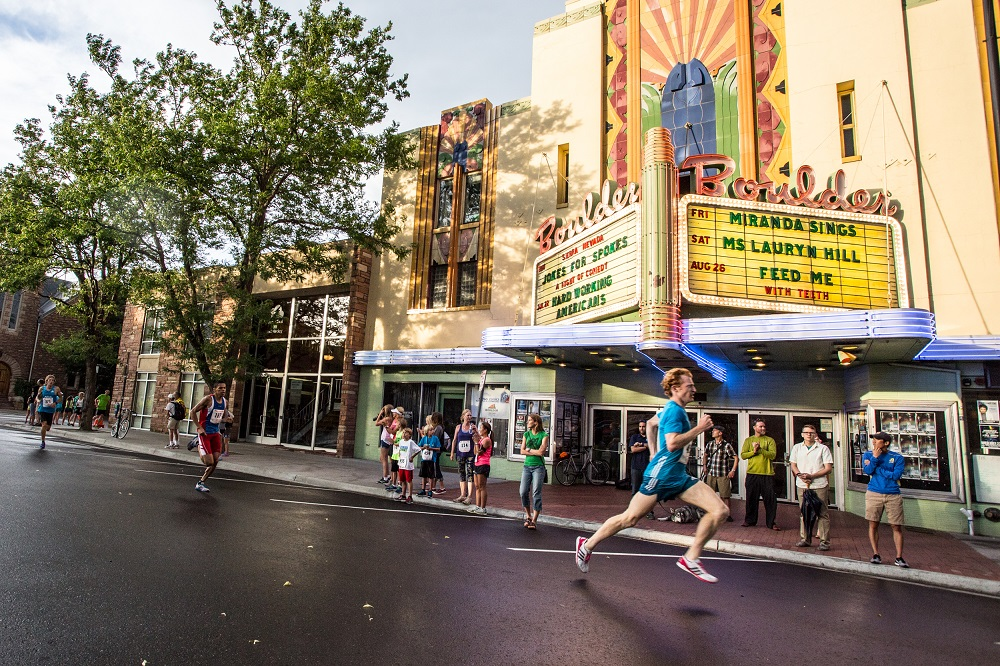 Runners pass the iconic Boulder Theatre on their way to the finish of the Pearl Street Mile - Part of the Downtown Boulder Race Series