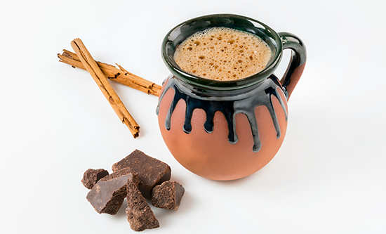 champurrado, a chocolate drink, served in a clay mug
