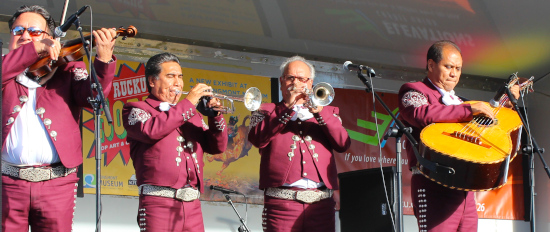 four mariachi musicians performing at a day of of the dead celebration
