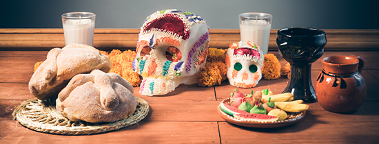 Sugar skulls, bread of the dead, and other food set out for day of the dead