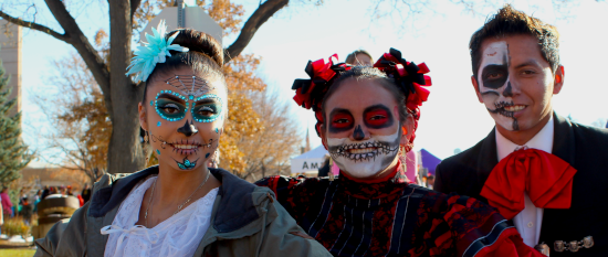 Three Day of the Dead dancers wearing face paint