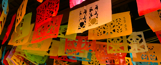 papel picado hanging at  day of the dead celebration