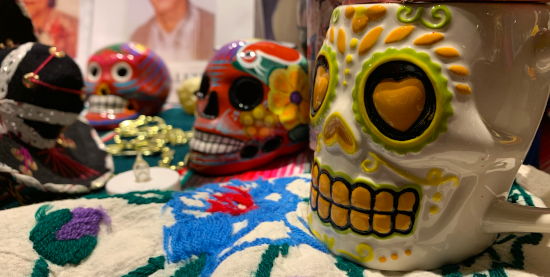 three skulls on a day of the dead altar