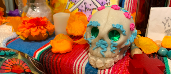 A sugar skull on a day of the dead altar