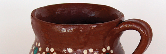 earthenware cup of water