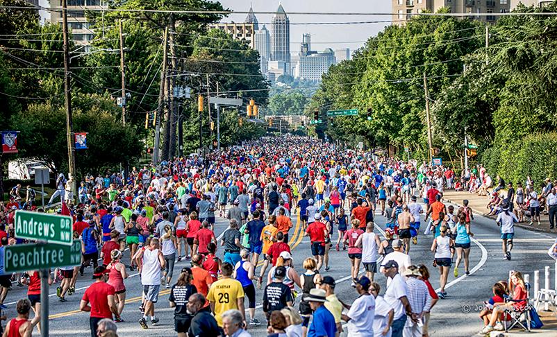 Runners head down Peachtree, leaving Buckhead for Midtown.