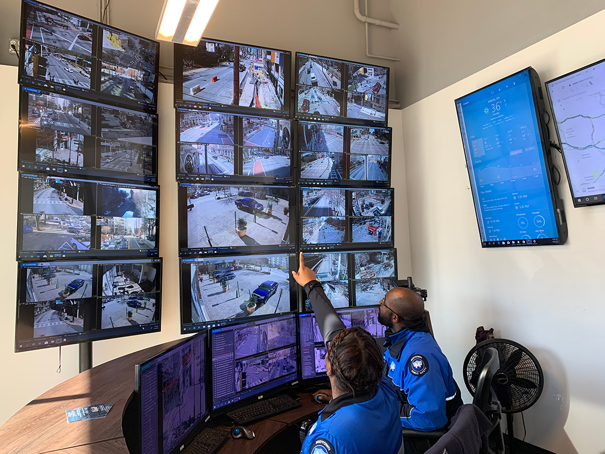Midtown Blue Public Safety Officers Kristian McClendon and Desmar Burton monitor live safety camera feeds.