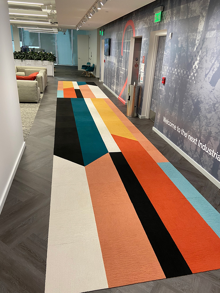 Base Camp's carpet, an Interface product, offers both directional signage and style. Photo credit: Interface
