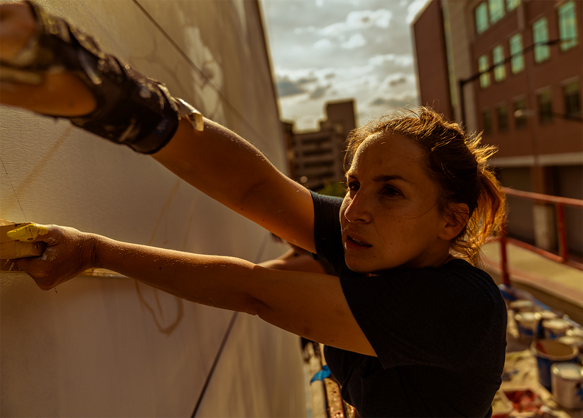 Vidal (pictured) and her assistant Helena Salvador will finish the mural June 5.