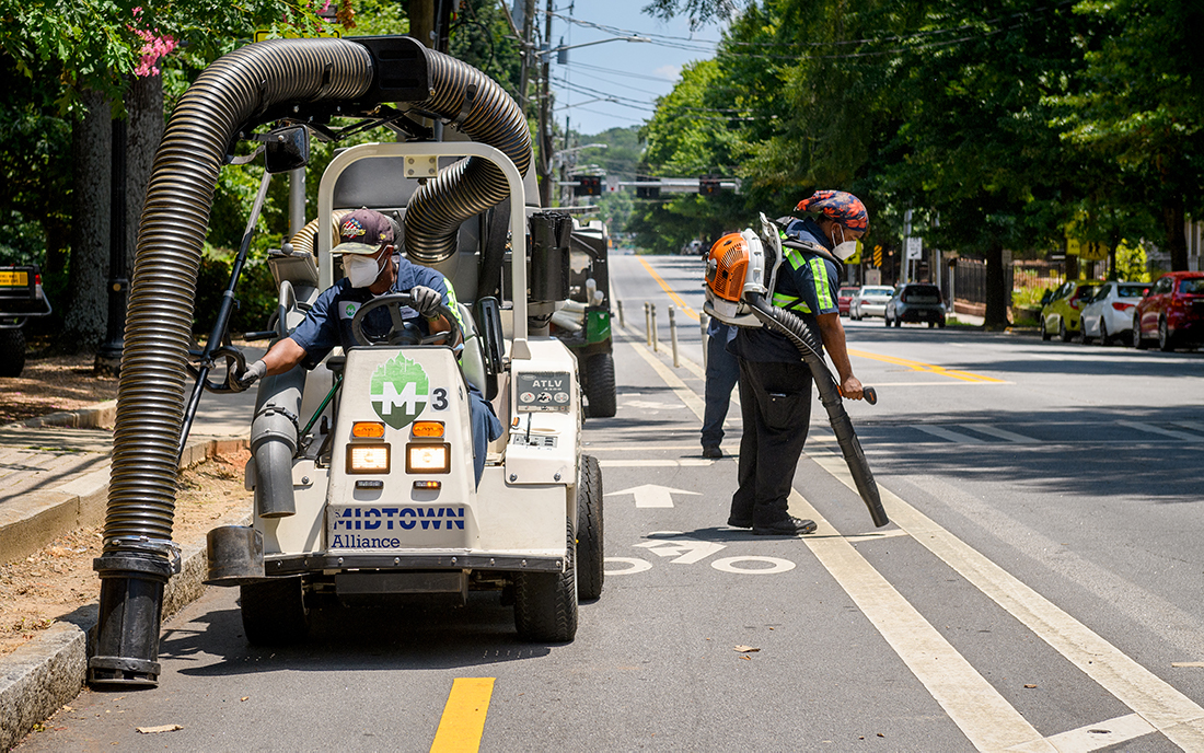 As part of the Midtown Green team, Andre Turner's duties include sanitizing high-touch areas, graffiti removal and cleaning trash and debris off the streets and sidewalks with an ATLV, or ride-on vacuum sweeper.