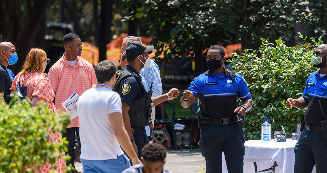 Midtown Blue Public Safety Officer DeShaun Jenkins greets an Atlanta Fed Police Officer.