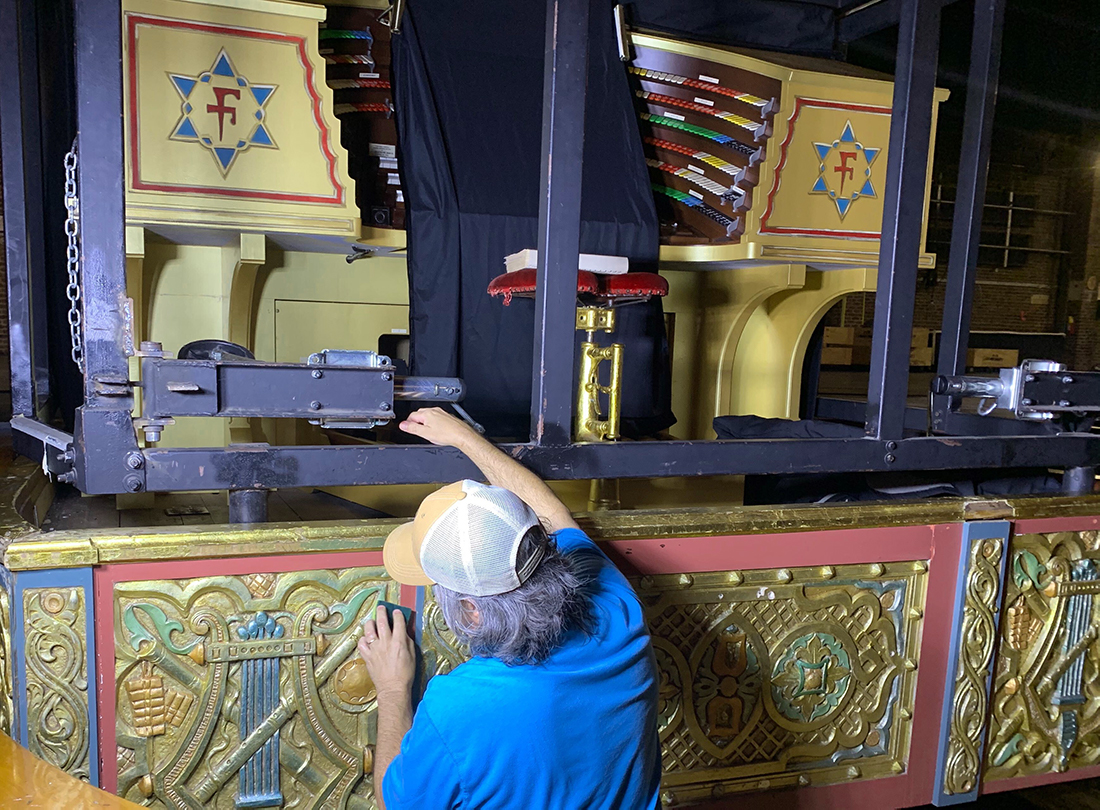 A tech cleans the organ skirt on Mighty Mo.