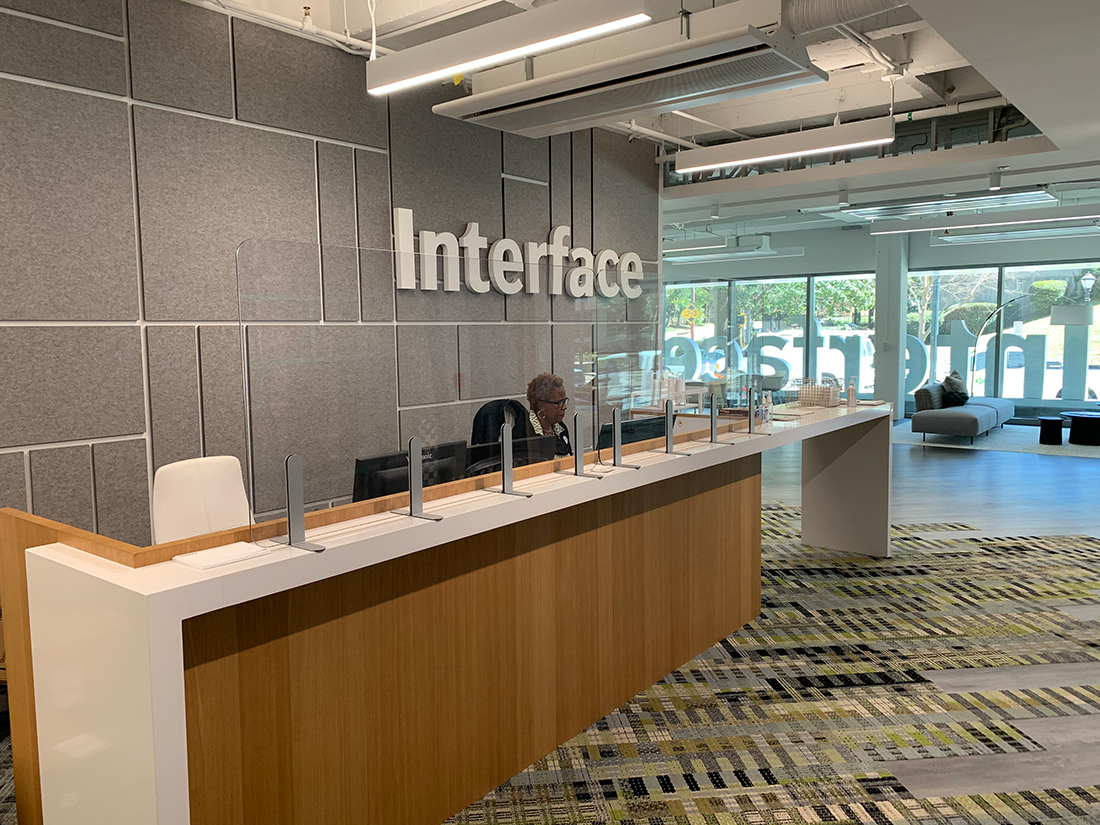 Interface's Base Camp has a new clear partition in the reception area for the protection of guests and employees.