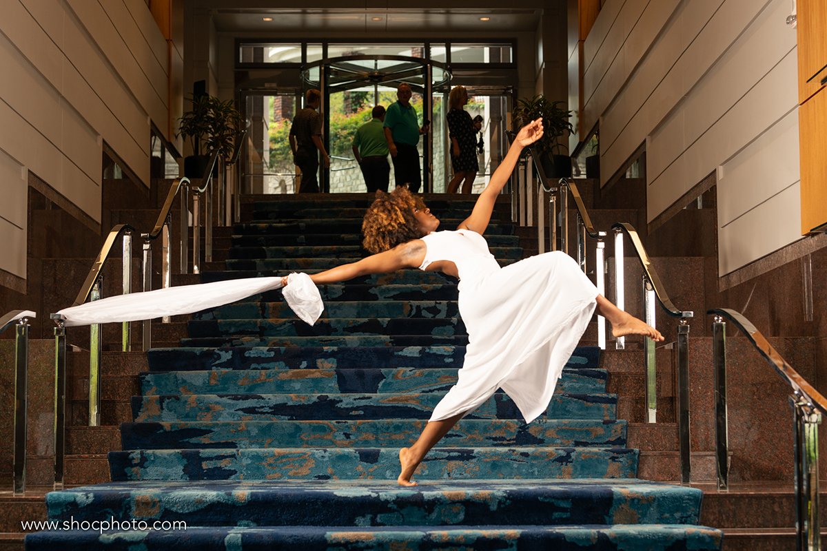 Two dancers on the staircase at Promenade.