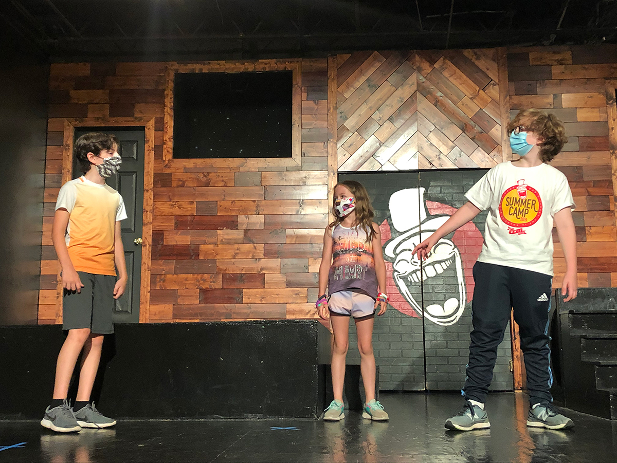 Kids at Whole World Theatre summer camp, which is celebrating its 18th year — albeit with some new safety precautions.
