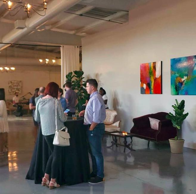 people standing in gallery