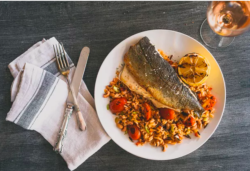plate with fish and rice, and wine