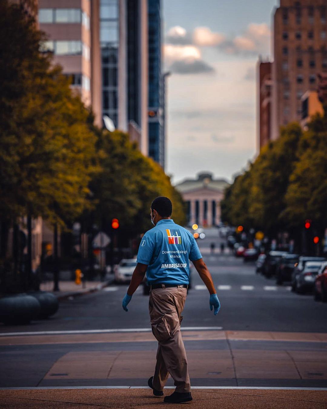 DRA Ambassador Kyle Williams walking down Fayetteville Street