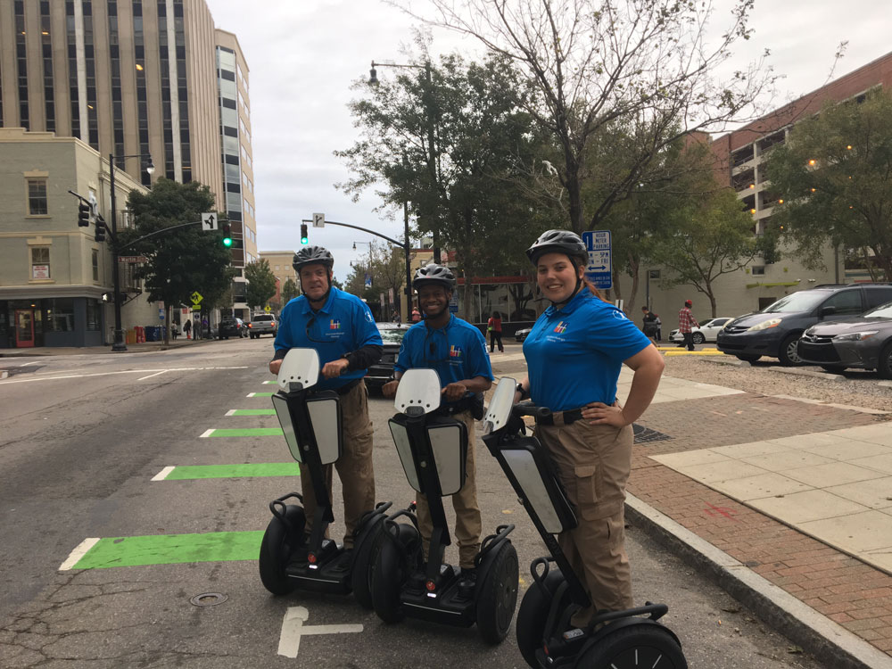 Downtown Raleigh Ambassadors standing on Segway vehicles