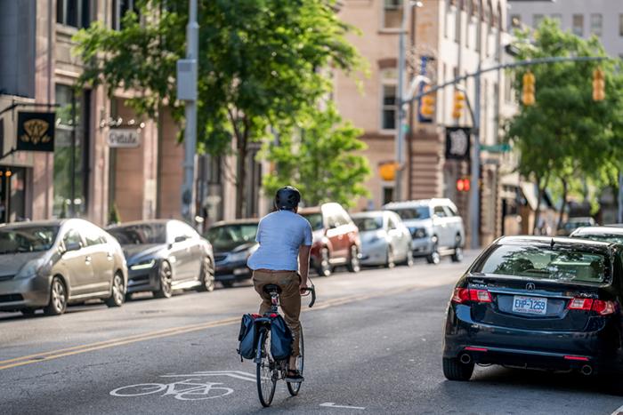 Man biking in the street in Downtown Raleigh