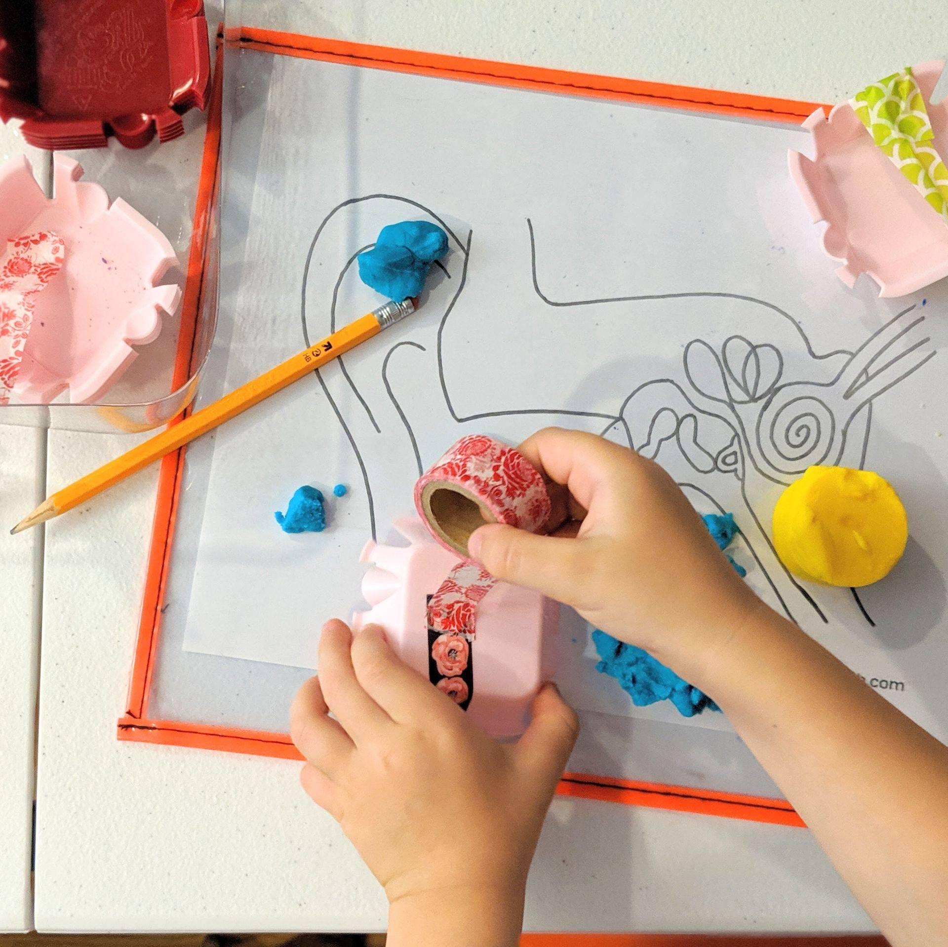 Child drawing at Kid Lab