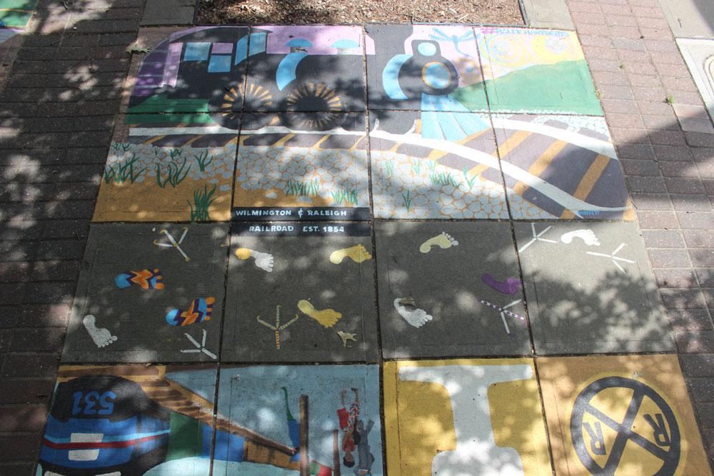 Train-themed sidewalk mural