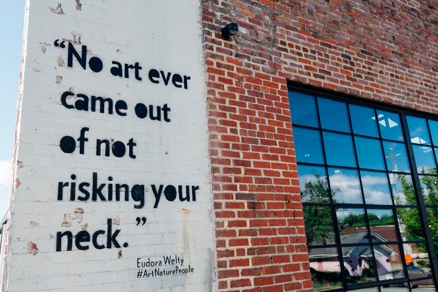"""Quote reading """"No art every came out of not risking your neck"""" by artist Eudora Wetly"""