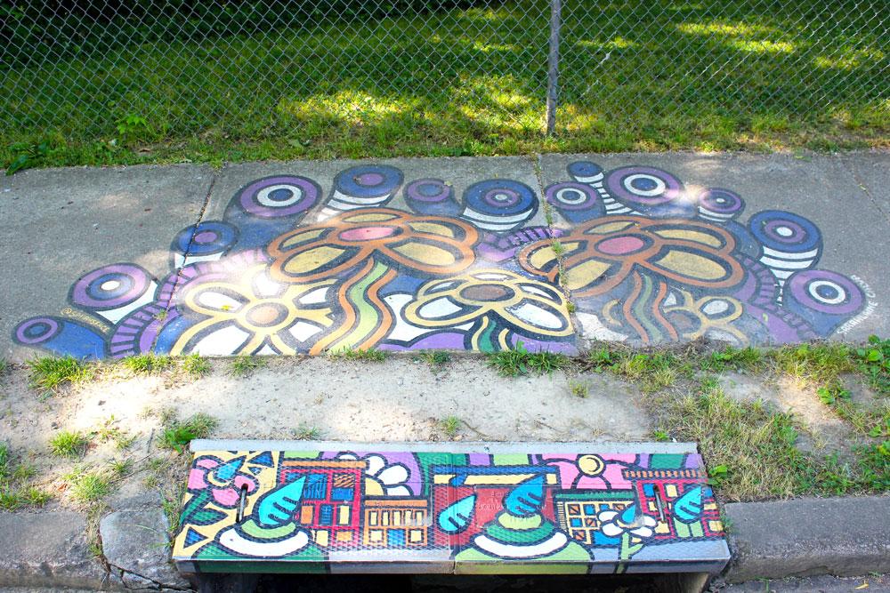 Mural on sidewalk and drain