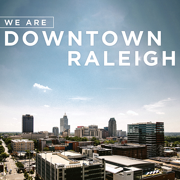 We Are Downtown Raleigh logo over skyline of Downtown Raleigh