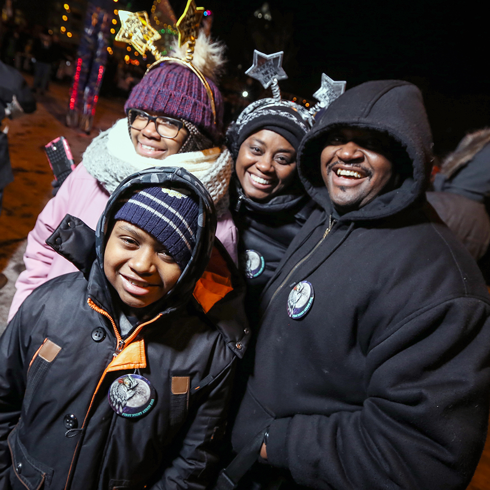Photograph by Jeff Klaum of a family visiting downtown Akron in the winter