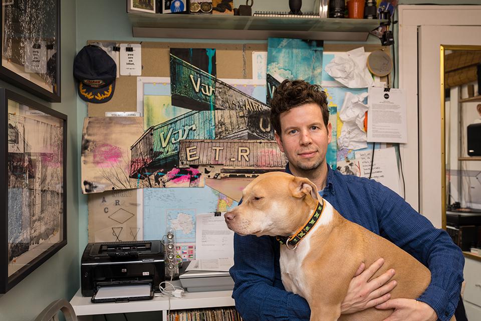 Photograph of artist Micah Kraus in his studio