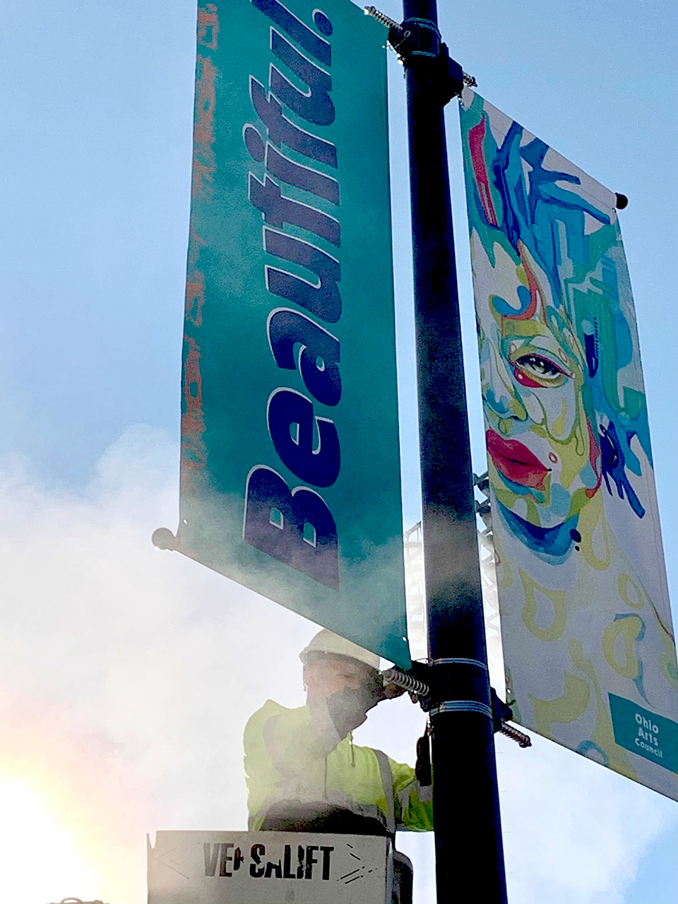 Photograph of city of Akron installation of We Are banner on a light pole