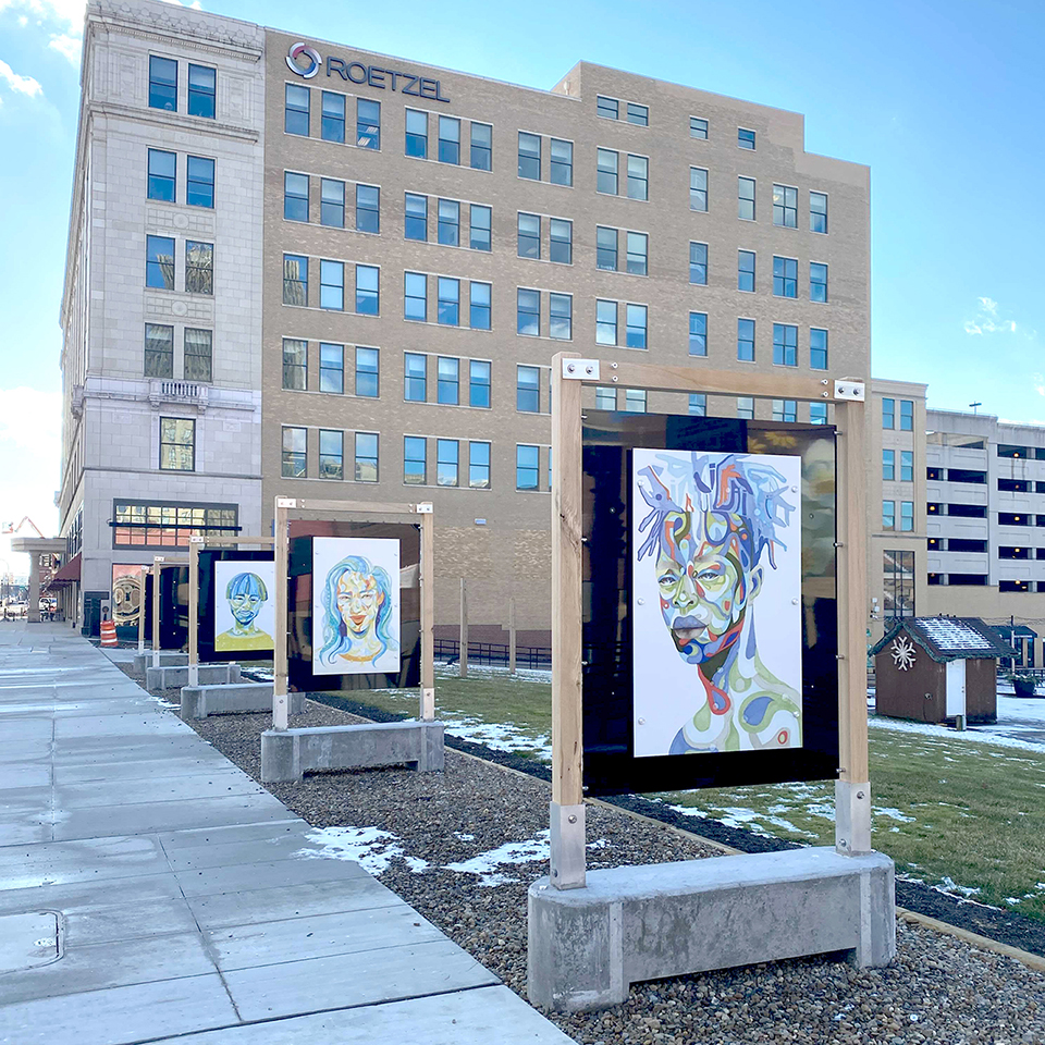 Photograph of We Are installed in the outdoor art gallery at Lock 3
